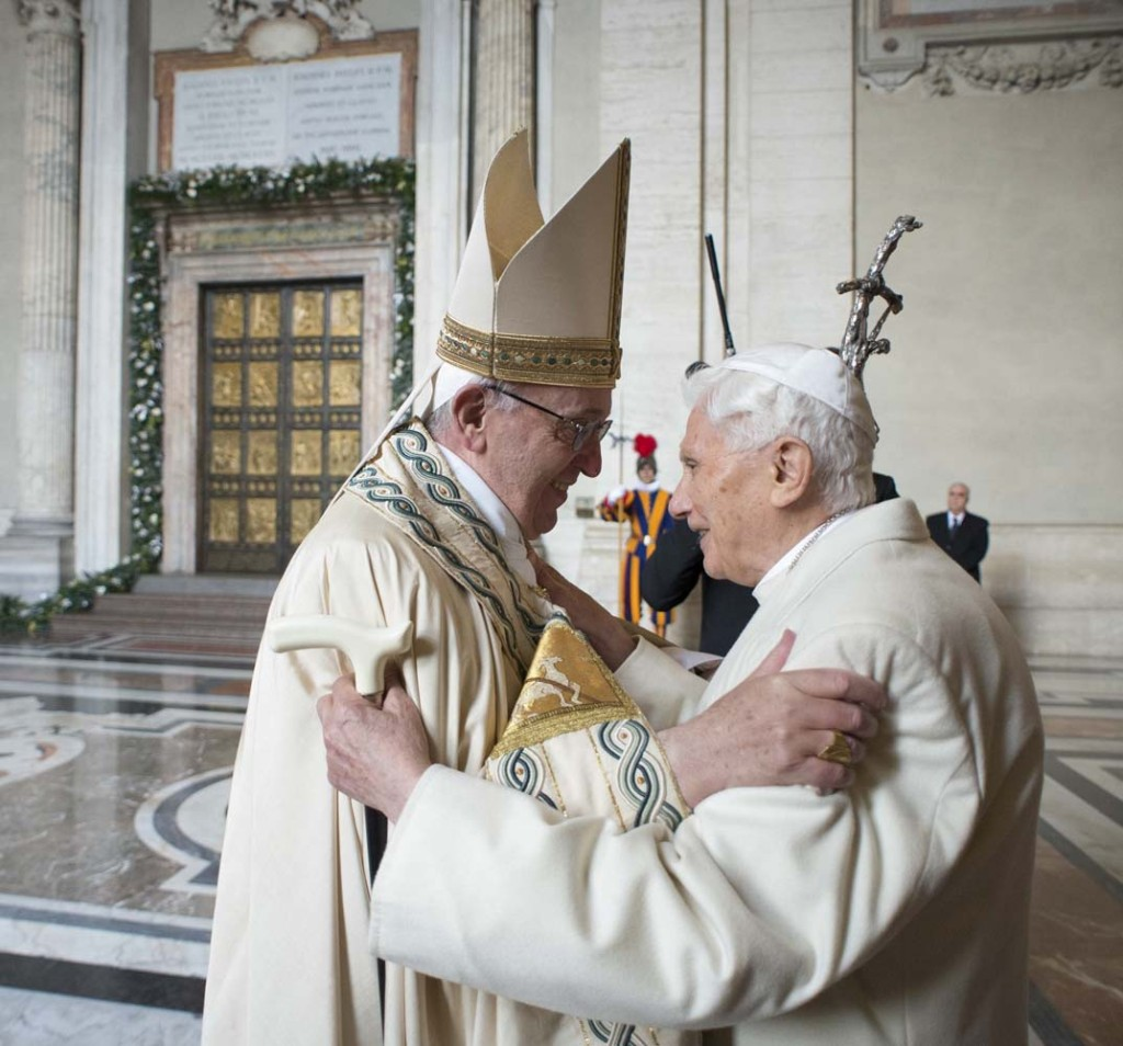 Pope Francis (L) embraces Emeritus Pope Benedict XVI before opening the Holy Door to mark opening of the Catholic Holy Year, or Jubilee, in St. Peter's Basilica, at the Vatican, December 8, 2015. REUTERS/Osservatore Romano/Handout via Reuters ATTENTION EDITORS - THIS IMAGE WAS PROVIDED BY A THIRD PARTY. REUTERS IS UNABLE TO INDEPENDENTLY VERIFY THE AUTHENTICITY, CONTENT, LOCATION OR DATE OF THIS IMAGE. IT IS DISTRIBUTED EXACTLY AS RECEIVED BY REUTERS, AS A SERVICE TO CLIENTS. FOR EDITORIAL USE ONLY. NOT FOR SALE FOR MARKETING OR ADVERTISING CAMPAIGNS. NO RESALES. NO ARCHIVE.