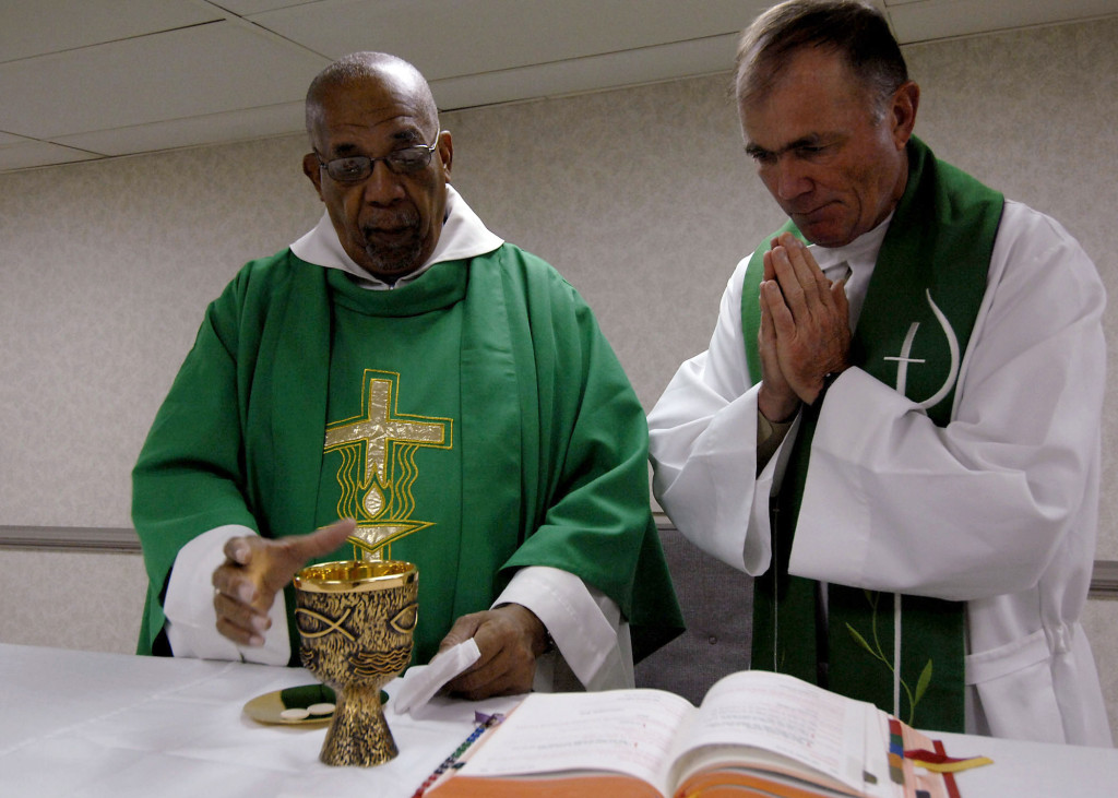 070921-N-6278K-002 PORT-OF-SPAIN, Trinidad and Tobago (Sept. 21, 2007) - Father Joseph Harris, left, a Roman Catholic priest in Trinidad and Tobago, celebrates mass with Lt. Cmdr. Paul Evers, a Navy chaplain and Roman Catholic priest, aboard Military Sealift Command hospital ship USNS Comfort (T-AH 20). Comfort is on a four-month humanitarian deployment to Latin America and the Caribbean providing medical treatment to patients in a dozen countries. U.S. Navy photo taken by Mass Communication Specialist 2nd Class Joan E. Kretschmer (RELEASED)
